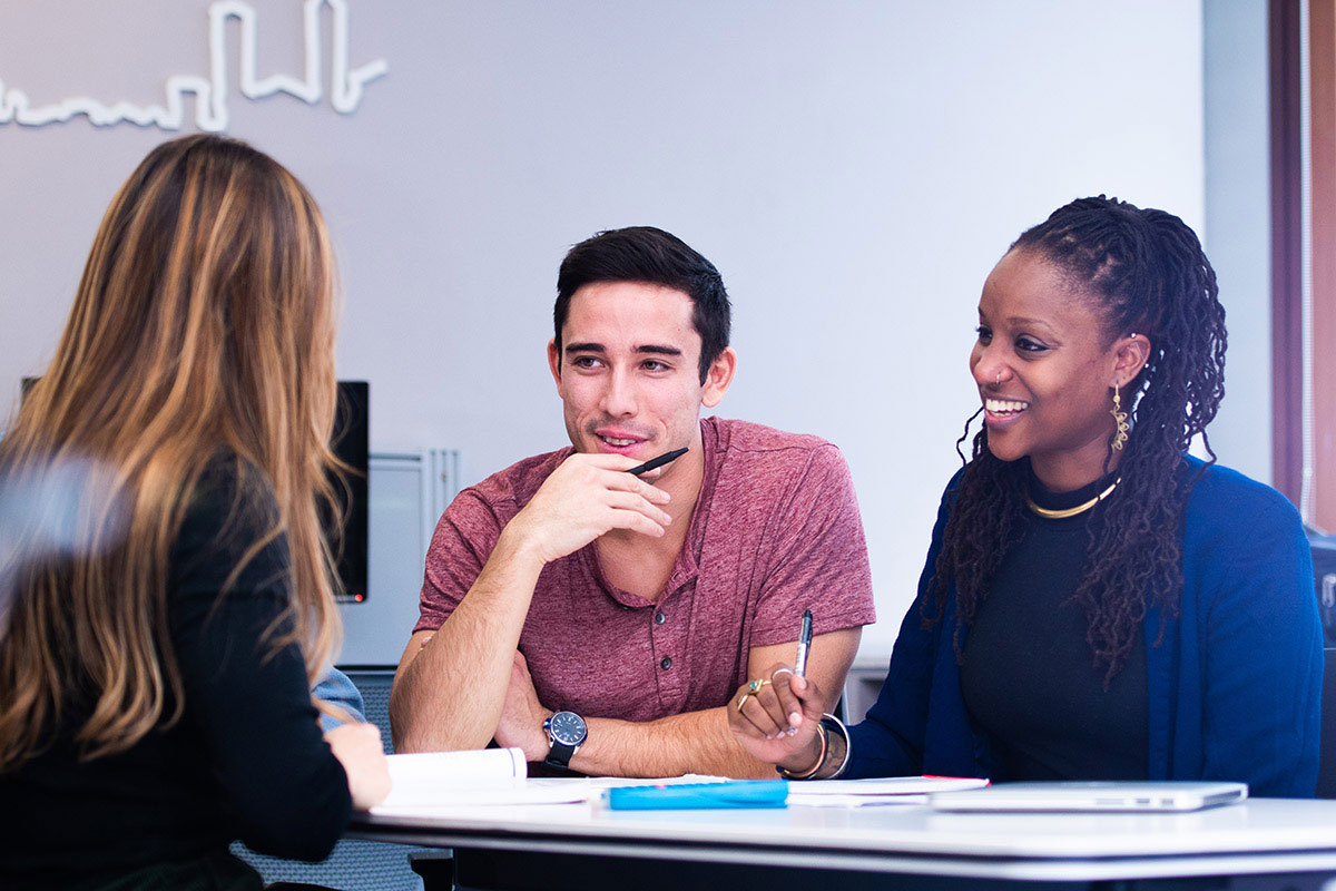 Two students discussing the program with an advisor